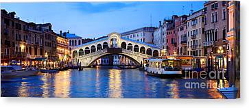 Rialto Bridge At Night Venice Italy Canvas Print by Matteo Colombo