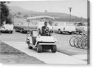Richard Nixon Driving A Golf Cart Canvas Print by Everett