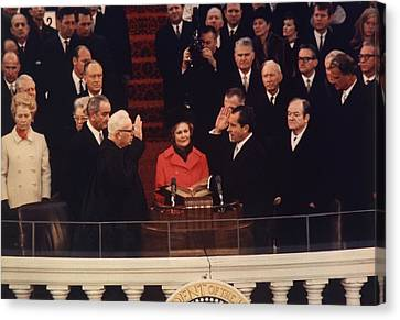 Richard Nixon Taking The Oath Of Office Canvas Print by Everett
