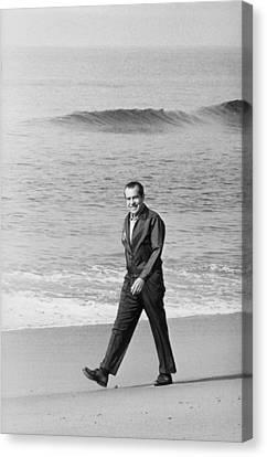 Richard Nixon Walking On The Beach Canvas Print by Everett