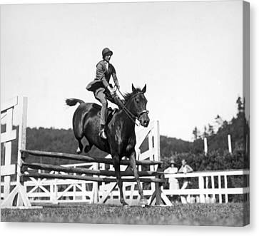 Rider Jumps At Horse Show Canvas Print by Underwood Archives