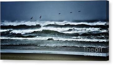 Riders On The Storm 1 - Outer Banks Canvas Print by Dan Carmichael