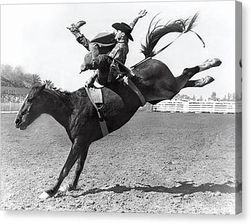 Jumping Horse Canvas Print - Riding A Bucking Bronco by Underwood Archives