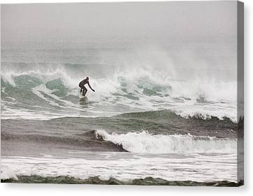 Riding The Waves In A Snow Storm Canvas Print by Tim Grams