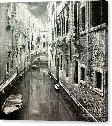 Venice Canal Canvas Print by Julie Woodhouse