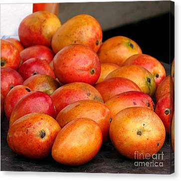 Ripe Red Mangoes For Sale Canvas Print by Yali Shi