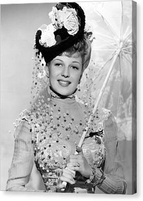 Rita Hayworth Under Umbrella Canvas Print