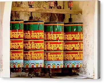 Ritual Prayer Wheels At A Buddhist Canvas Print by Jaina Mishra