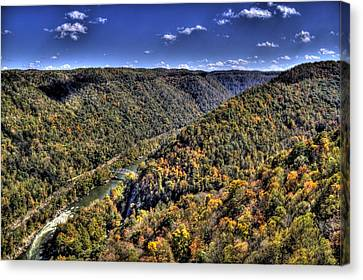 River Running Through A Valley Canvas Print