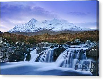 Waterfall And The Cuillins Canvas Print by Rod McLean