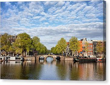 River View Of Amsterdam In The Netherlands Canvas Print by Artur Bogacki
