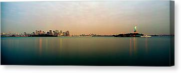River With The City Skyline And Statue Canvas Print