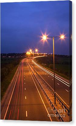 Road And Traffic At Night Canvas Print by Colin and Linda McKie