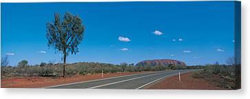 Road Ayers Rock Uluru-kata Tjuta Canvas Print by Panoramic Images