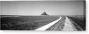 Road Passing Through A Landscape, Mont Canvas Print by Panoramic Images