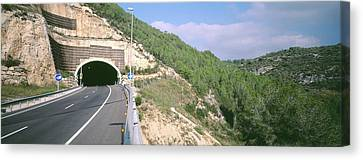 Road Passing Through A Tunnel, Sitges Canvas Print by Panoramic Images