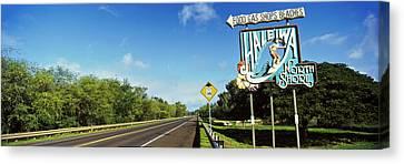 Road Sign At The Roadside, Haleiwa Canvas Print by Panoramic Images