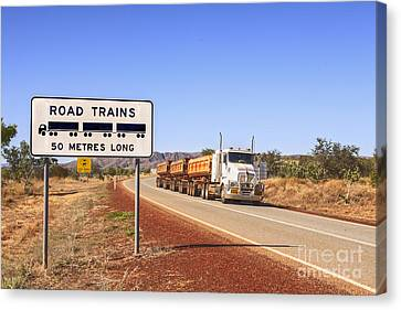 Road Train Warning Sign And Roadtrain Just Passing By Canvas Print by Colin and Linda McKie