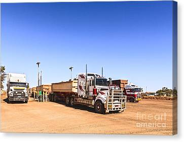 Road Trains Refuelling Canvas Print by Colin and Linda McKie