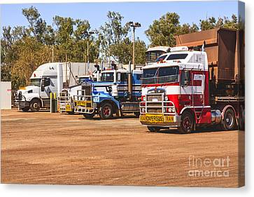 Road Trains Taking On Gas Or Diesel Canvas Print by Colin and Linda McKie