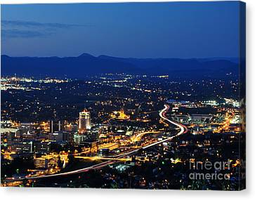 Roanoke City As Seen From Mill Mountain Star At Dusk In Virginia Canvas Print by Paul Fearn