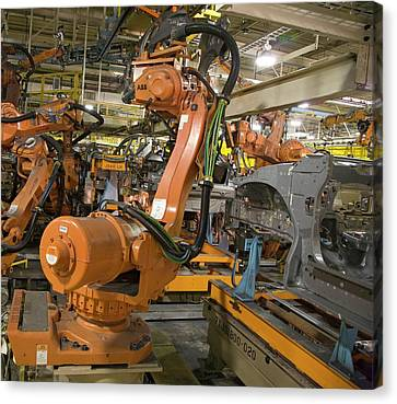 Robot On Car Assembly Production Line Canvas Print by Jim West