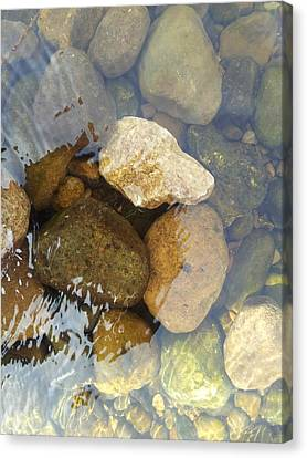 Rock And Pebbles Canvas Print by David Stribbling