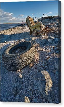 Rock Bounces Off Tire Rock Breaks Chair Canvas Print by Scott Campbell
