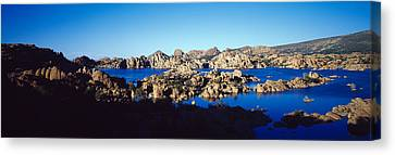 Rock Formations At Lake, Granite Dells Canvas Print by Panoramic Images
