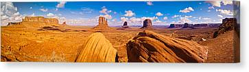 Rock Formations At Monument Valley Canvas Print by Panoramic Images