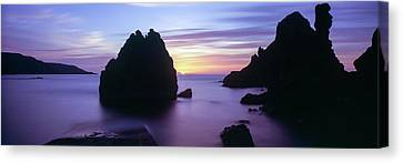 Rock Formations In The Sea At Sunset Canvas Print by Panoramic Images