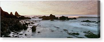 Roca Canvas Print - Rock Formations On Beach At Sunrise by Panoramic Images