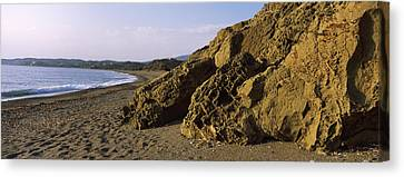 Rock Formations On The Beach, Chios Canvas Print by Panoramic Images