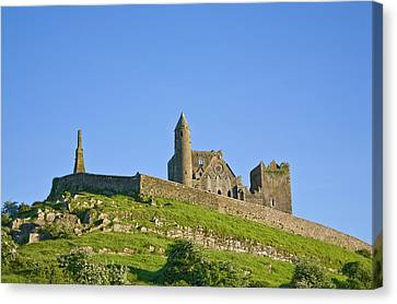 Rock Of Cashel, Site Of Monastic Canvas Print by Panoramic Images