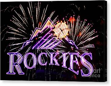 Rockies And Fireworks Canvas Print by Bob Hislop