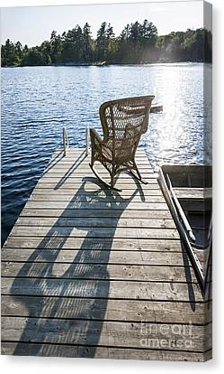 Rocking Chair On Dock Canvas Print by Elena Elisseeva