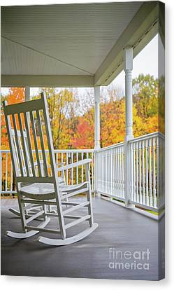Rocking Chairs On A Porch In Autumn Canvas Print by Diane Diederich