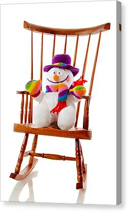 Canvas Print featuring the photograph Happy Snowman Sitting In A Rocking Chair  by Vizual Studio