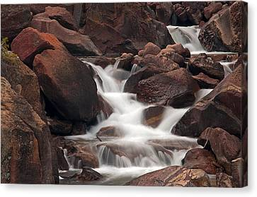 Rocks And Water Canvas Print by Eric Rundle