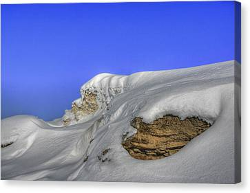 Rocks Covered With Snow Against Clear Blue Sky Canvas Print