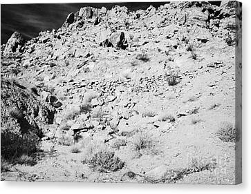 Rocks Forming Support For The Old Arrowhead Trail Road Valley Of Fire State Park Nevada Usa Canvas Print by Joe Fox
