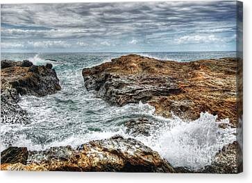 Rocks Ocean And Clouds Canvas Print by Kaye Menner