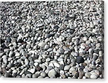 Rocks Of The Greek Canvas Print by John Rizzuto