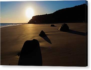 Sandy Beach Canvas Print - Rocks On Sandy Beach At Sunset by Wladimir Bulgar