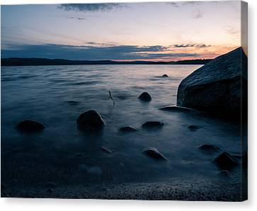Rocks At A Shore Canvas Print by Janne Mankinen