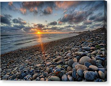Rocky Coast Sunset Canvas Print by Peter Tellone