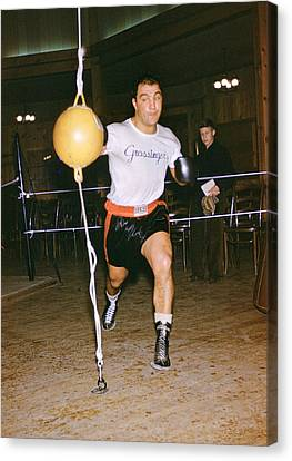 Rocky Marciano Striking Bag Canvas Print by Retro Images Archive