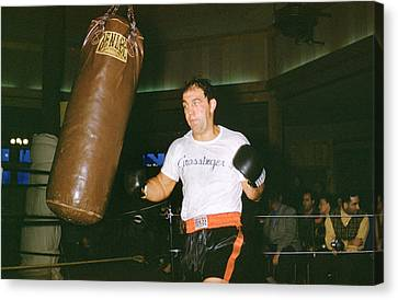 Rocky Marciano Working Heavy Bag Canvas Print by Retro Images Archive