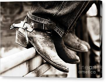 Canvas Print featuring the photograph Rodeo Boots And Spurs In Black And White by Lincoln Rogers