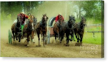 Rodeo Chuck Wagons On The Run Canvas Print by Bob Christopher
